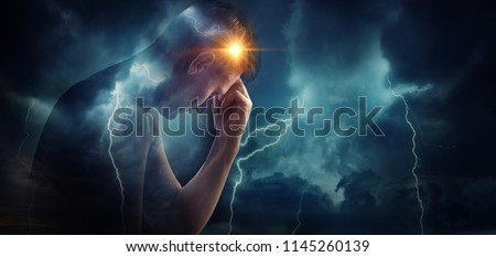 Storm sky with lightning and sun on the background of the silhouette of a man. Concept on the problem of personality, psychology, psychiatry. Medical diseases (migraine and headache pain).