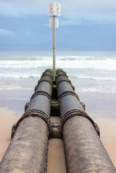 Storm water pipes running into the ocean