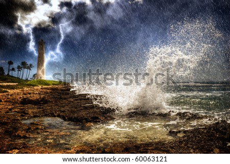 Storm wave lightning weather rain coast tropical island. Large wave crashing into rocky coast as rain pours down, lightning striking Barber's Point Lighthouse in the distance, Oahu Hawaii.