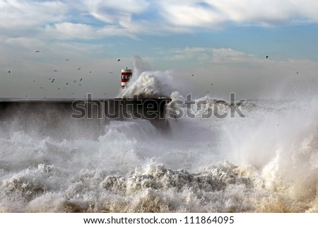 Storm waves over beacon and pier of the harbor of river Douro, Portugal - stock photo