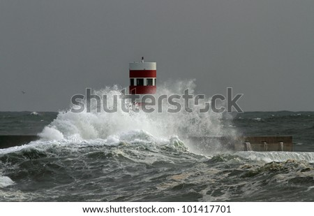 Storm waves over beacon of the harbor of Douro, Porto, Portugal