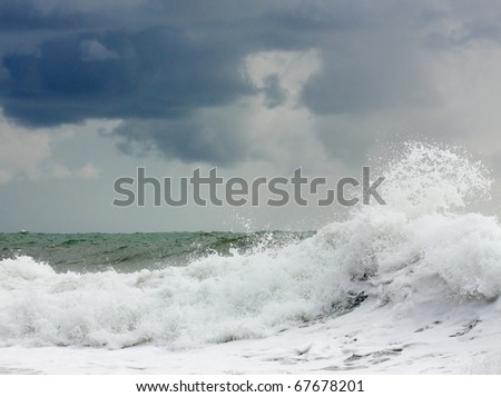 Storming sea with a thundercloud above
