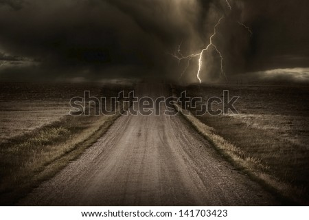 Stormy Back Country Road. Heavy Storm and Lightning Bolt in a Distans. Severe Weather Imagery Collection.