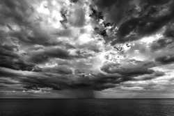 stormy clouds and rain over the sea