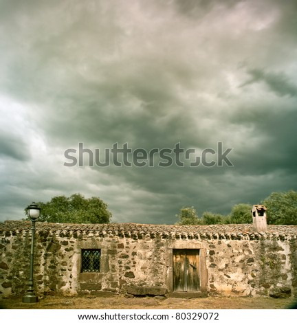 stormy clouds over ancient building dramatic sky and cloudscape
