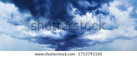 Stormy cloudy sky panorama, dramatic dark blue thunderclouds, gale clouds, thunderstorm landscape wide format, overcast weather, hurricane cloudiness skies, tornado, cloudscape, panoramic heaven view ストックフォト ©