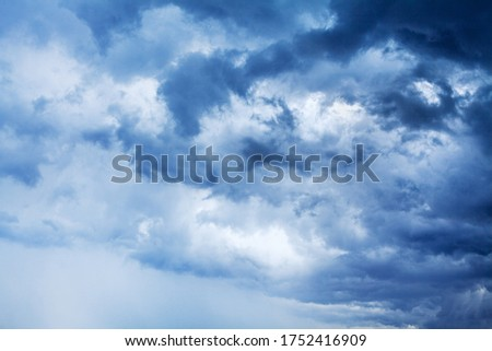 Stormy cloudy sky panorama, dramatic dark blue thunderclouds, white fluffy cumulus clouds close up, thunderstorm landscape, overcast bad weather, cloudiness skies, cloudscape, atmosphere, heaven, air ストックフォト ©