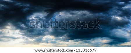 Stormy dark blue sky. High resolution panorama from several photos.
