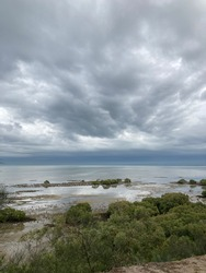 stormy dramatic sky over quiet waters of bay