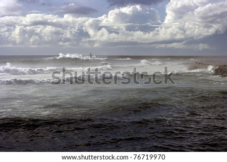 Stormy evening in the north Portuguese coast seeing dramatic white clouds an waves - stock photo