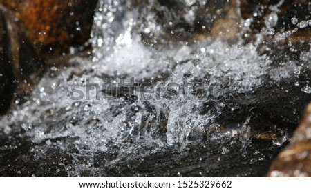 Stormy flow of crystal clear and clear water