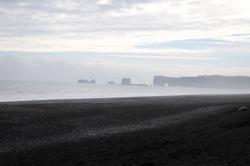 Stormy, moody day on black sand beach Reynisfjara on the south of Iceland, Europe, huge waves on Atlantic Ocean