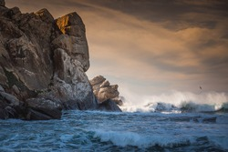 Stormy Pacific ocean and Morro Rock at sunset. Morro Bay State Park, California coastline