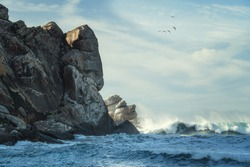 Stormy Pacific ocean and Morro Rock. Morro Bay State Park, California coastline