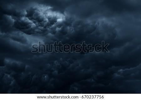 Stormy rain clouds background. Dark sky #670237756
