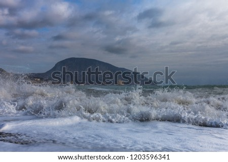 Stormy sea and Ayu-Dag mountain