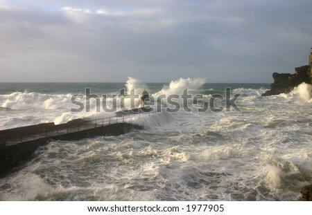 Stormy sea and waves breaking on the quay, Portreath, Cornwall
