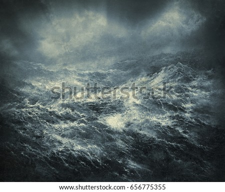 Stormy sea with big restless waves and ominous sky.