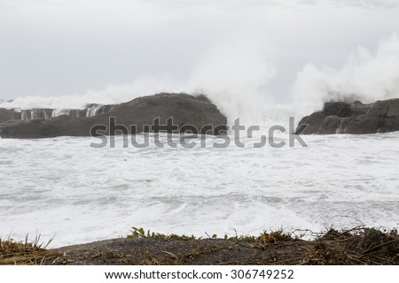 Stormy sea with waves crashing on rocks during Typhoon Souledor #306749252