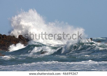Stormy seas and crashing waves on rocks