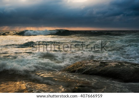Stormy seascape with reflective wet rock and flowing water #407666959