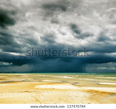 Stormy sky and beach at low tide.