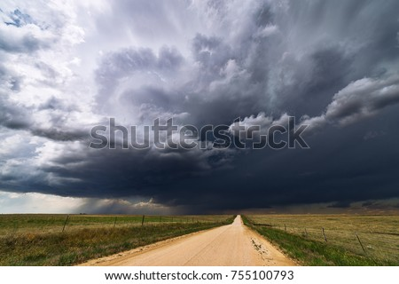 Stormy sky and dirt road