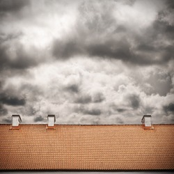 stormy sky and tiled roof top background