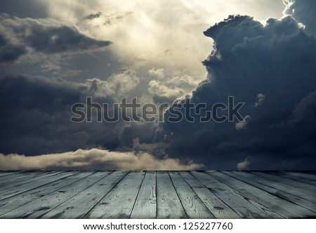 stormy sky and wooden floor ...