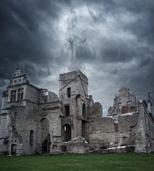 Stormy sky over ruins of manor house