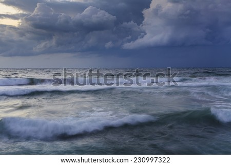Stormy sky over the wave of the sea.  #230997322