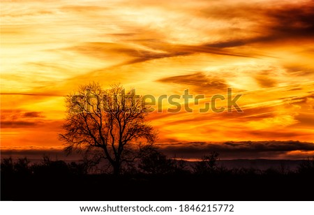 Stormy sunset sky clouds view. Sunset sky clouds. Orange sunset sky. Sunset skt clouds