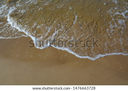 Stormy water glisten in the sun