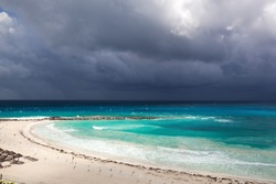 Stormy weather in Cancun, beautiful turquoise sea under dark blue clouds, view from above