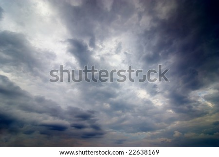 stormy weather with dark clouds in the dramatic sky