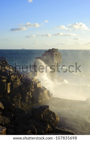Stormy winter conditions at Pulpit Rock on Portland, Dorset England.