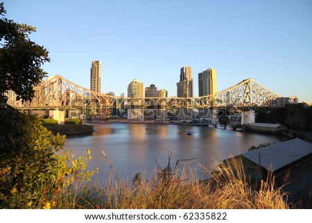 Story Bridge and the Brisbane city skyline in Australia in the early morning light.