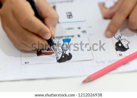 Storyboard drawing with pencil creative sketch cartoon. Storyboarding is process image displayed in sequence for purpose of pre-visualizing motion picture, interactive media. Concept sketching ideas. #1212026938