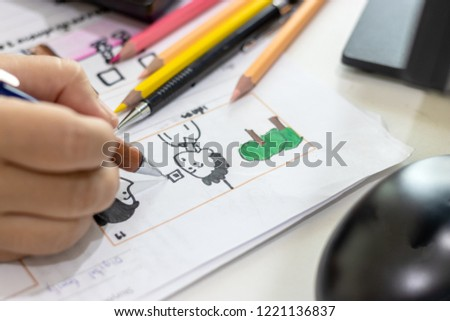 Storyboard drawing with pencil creative sketch cartoon. Storyboarding is process image displayed in sequence for purpose of pre-visualizing motion picture, interactive media. Concept sketching ideas. #1221136837