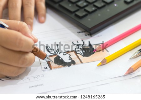 Storyboard drawing with pencil creative sketch cartoon. Storyboarding is process image displayed in sequence for purpose of pre-visualizing motion picture, interactive media. Concept sketching ideas. #1248165265