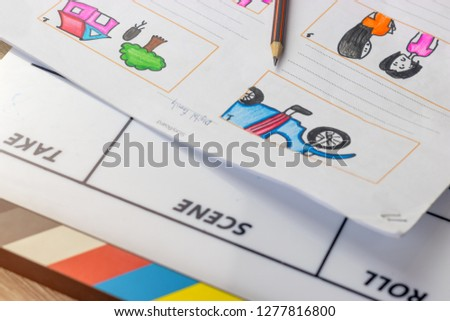 Storyboard drawing with pencil creative sketch cartoon. Storyboarding is process image displayed in sequence for purpose of pre-visualizing motion picture, interactive media. Concept sketching ideas. #1277816800