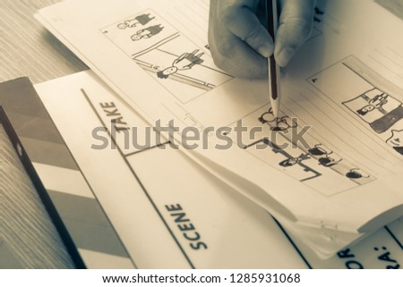 Storyboard drawing with pencil creative sketch cartoon. Storyboarding is process image displayed in sequence for purpose of pre-visualizing motion picture, interactive media. Concept sketching ideas. #1285931068