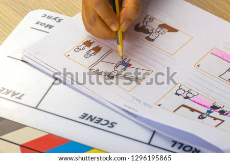 Storyboard drawing with pencil creative sketch cartoon. Storyboarding is process image displayed in sequence for purpose of pre-visualizing motion picture, interactive media. Concept sketching ideas. #1296195865