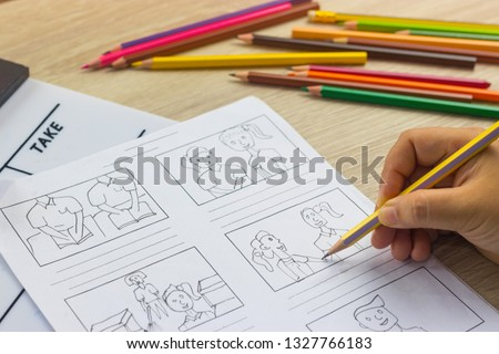 Storyboard drawing with pencil creative sketch cartoon. Storyboarding is process image displayed in sequence for purpose of pre-visualizing motion picture, interactive media. Concept sketching ideas. #1327766183