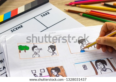 Storyboard drawing with pencil creative sketch cartoon. Storyboarding is process image displayed in sequence for purpose of pre-visualizing motion picture, interactive media. Concept sketching ideas. #1328031437