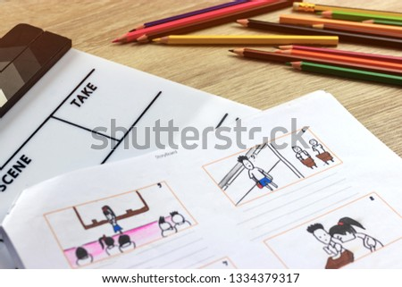 Storyboard drawing with pencil creative sketch cartoon. Storyboarding is process image displayed in sequence for purpose of pre-visualizing motion picture, interactive media. Concept sketching ideas. #1334379317
