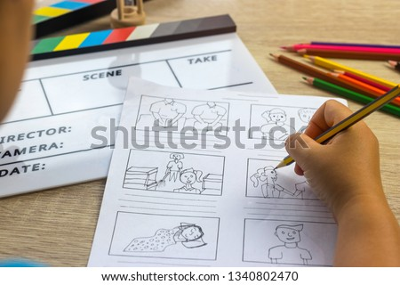 Storyboard drawing with pencil creative sketch cartoon. Storyboarding is process image displayed in sequence for purpose of pre-visualizing motion picture, interactive media. Concept sketching ideas. #1340802470