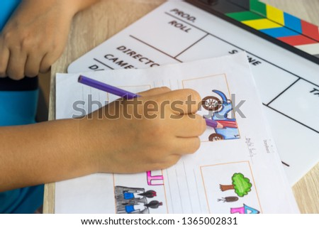 Storyboard drawing with pencil creative sketch cartoon. Storyboarding is process image displayed in sequence for purpose of pre-visualizing motion picture, interactive media. Concept sketching ideas. #1365002831