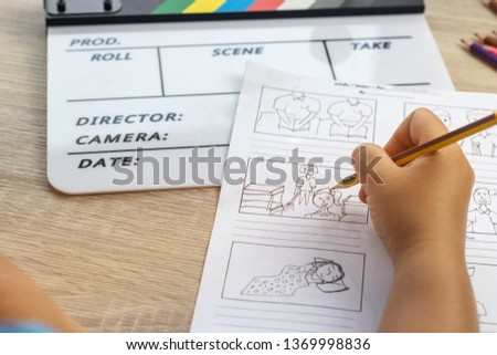 Storyboard drawing with pencil creative sketch cartoon. Storyboarding is process image displayed in sequence for purpose of pre-visualizing motion picture, interactive media. Concept sketching ideas. #1369998836