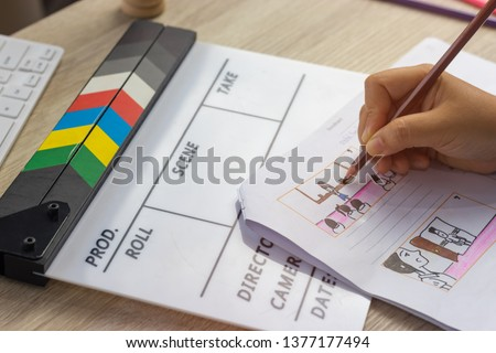Storyboard drawing with pencil creative sketch cartoon. Storyboarding is process image displayed in sequence for purpose of pre-visualizing motion picture, interactive media. Concept sketching ideas. #1377177494